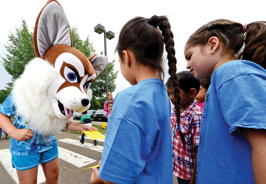 Hour photo / Erik Trautmann The Fox Run Elementary School mascot signs lap cards as the school holds their annual fundraising walkathon where students gather sponsors to help reach the fundraising goal of $10,000.00. The fundraiser will benefit a plan to buy air conditioners for all the classrooms and new playground equipment.