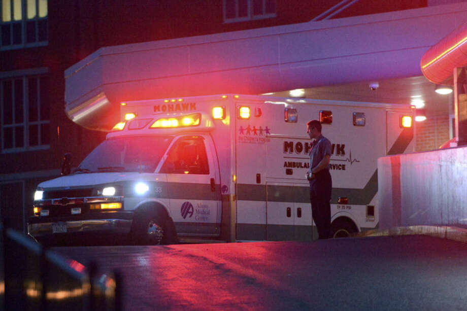 An ambulance carrying escaped convict David Sweat arrives at at Albany Medical Center on Sunday, June 28, 2015, in Albany, N.Y. The second of two convicted murderers who staged a brazen escape three weeks ago from a maximum-security prison in northern New York was shot and captured near the Canadian border on Sunday, two days after his fellow inmate was killed in a confrontation with law enforcement, authorities said. (Patrick Dodson/The Daily Gazette via AP)
