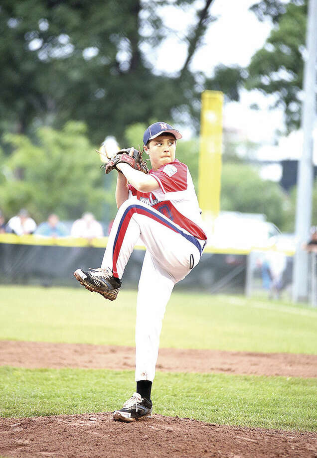 Hour photo/Danielle CallowayNorwalk's Cooper Grillo pitches a strike against Stamford National during a District 1 12-year-old Little League All-Star Game at Scalzi Park in Stamford Sunday evening.