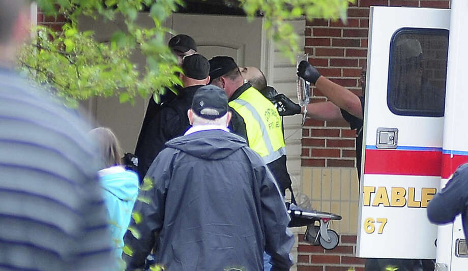 Prison escapee David Sweat, is wheeled in to Alice Hyde Medical Center, after being shot and captured Sunday, June 28, 2015, in Malone, N.Y. The second of two convicted murderers who staged a brazen escape three weeks ago from a maximum-security prison in northern New York was captured near the Canadian border on Sunday, two days after his fellow inmate was killed in a confrontation with law enforcement, authorities said. (Rob Fountain/The Press-Republican via AP)