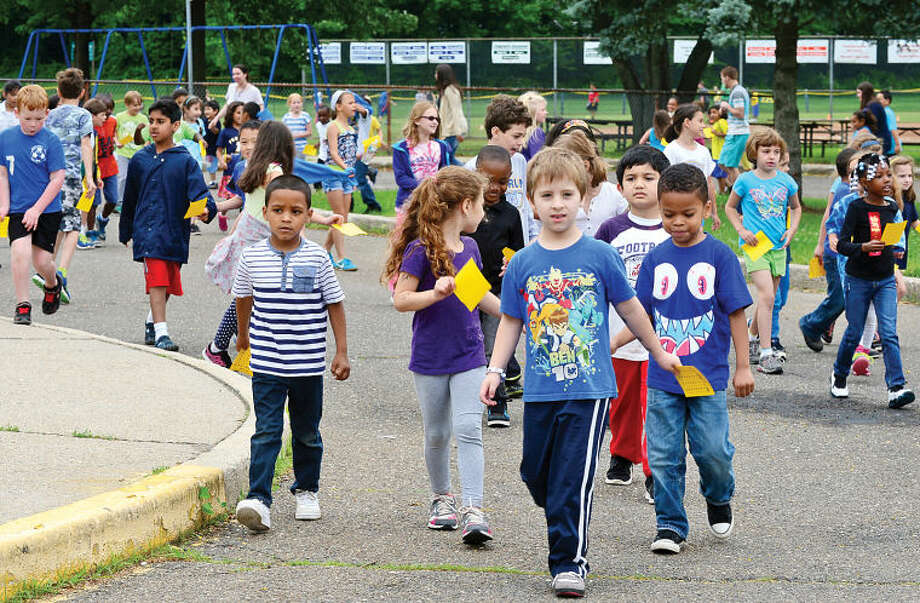 Hour photo / Erik Trautmann Fox Run Elementary School holds their annual fundraising walkathon where students gather sponsors to help reach the fundraising goal of $10,000.00. The fundraiser will benefit a plan to buy air conditioners for all the classrooms and new playground equipment.