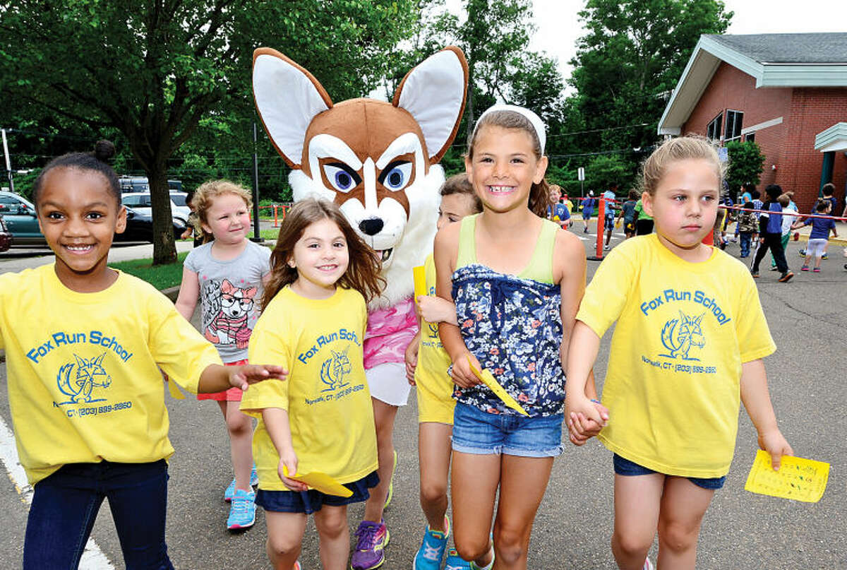 Hour photo / Erik Trautmann Fox Run Elementary School students Njeri Morgan, Jessica Claps, Abigail Ortolano and Zahra Riordon walk together as the school holds their annual fundraising walkathon where students gather sponsors to help reach the fundraising goal of $10,000.00. The fundraiser will benefit a plan to buy air conditioners for all the classrooms and new playground equipment.