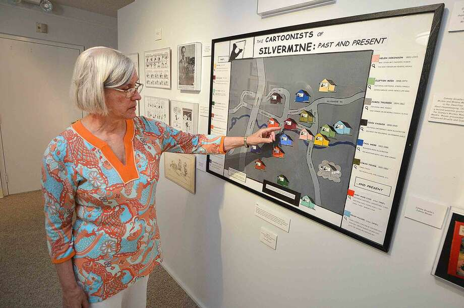 "Mary Anne Case, cartoonist and curator of the upcoming exhibit ""The Cartoonists of Silvermine: Past and Present"" points out where they lived and had studios on a map by Frank Bordonaro in 2012."