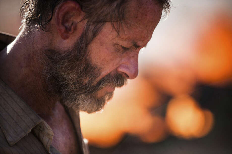 "This image released by A24 Films shows Guy Pearce in a scene from ""The Rover."" (AP Photo/A24 Films, Matt Nettheim, Matt Nettheim)"