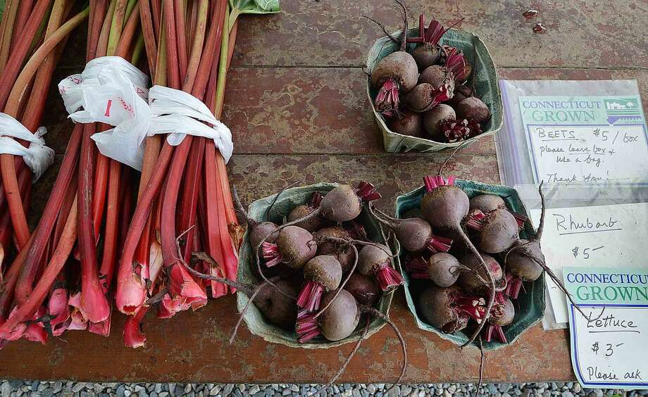 Hour Photo/Alex von Kleydorff Bunches of Rhubarb and fresh picked beets offered at Offingers Farm stand in Wilton