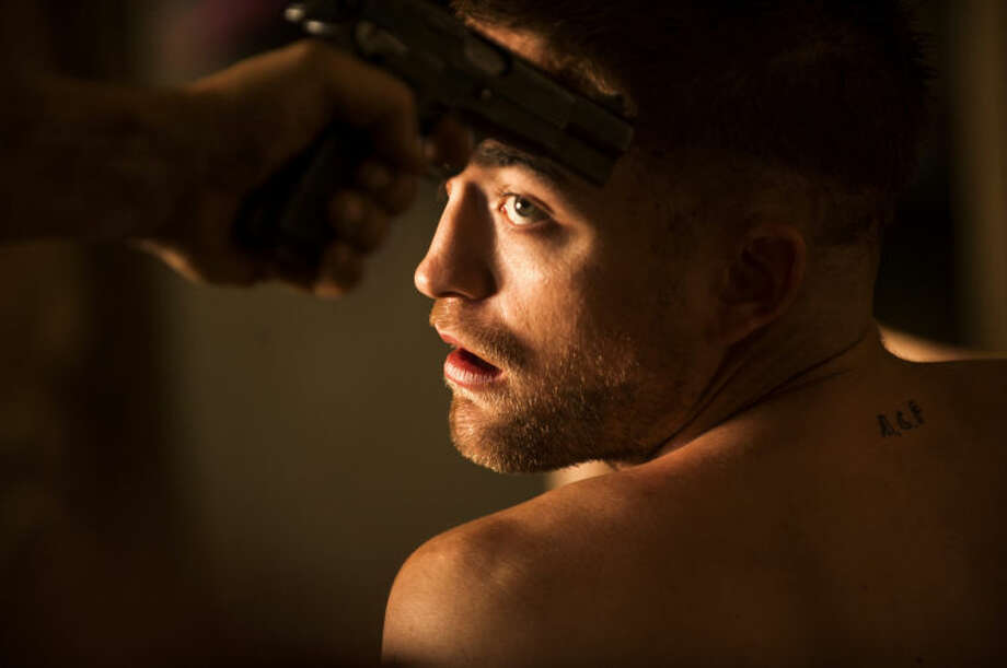 "This image released by A24 Films shows Robert Pattinson in a scene from ""The Rover."" (AP Photo/A24 Films, Matt Nettheim)"