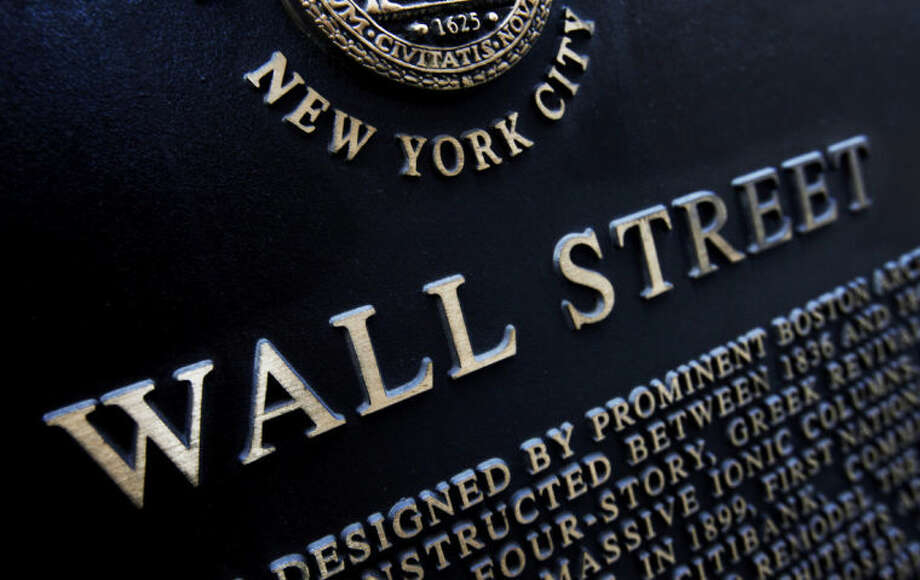 FILE - This Jan. 4, 2010 file photo shows an historic marker on Wall Street in New York. The stock market drifted lower Tuesday, June 10, 2014, after major indexes reached another record high the day before. (AP Photo/Mark Lennihan, File)