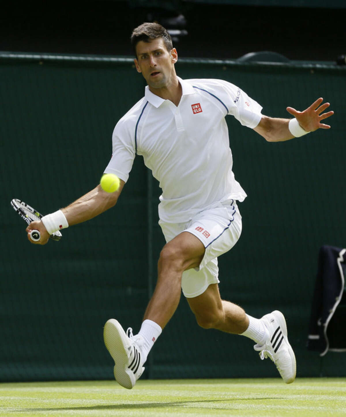 Novak Djokovic of Serbia plays a return to Philipp Kohlschreiber of Germany during the men's singles first round match at the All England Lawn Tennis Championships in Wimbledon, London, Monday June 29, 2015. (AP Photo/Kirsty Wigglesworth)