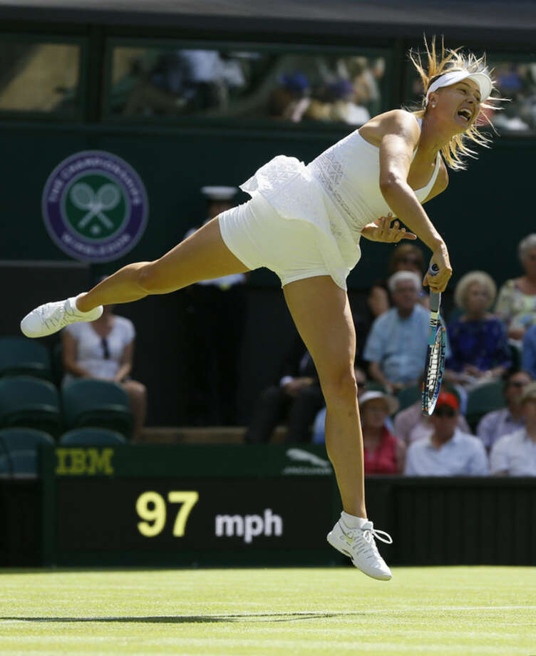 Maria Sharapova of Russia serves to Johanna Konta of Britain during the women's singles first round match at the All England Lawn Tennis Championships in Wimbledon, London, Monday June 29, 2015. (AP Photo/Kirsty Wigglesworth)