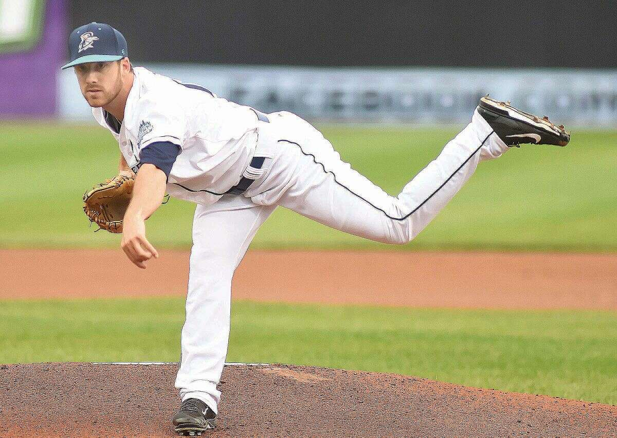 Hour photo/John Nash - Bridgeport Bluefish pitcher Matt Iannazzo, a Norwalk High product, follows through on a delivery to the plate during Thursday's game against Southern Maryland at The Ballpark at Harbor Yard in Bridgeport.