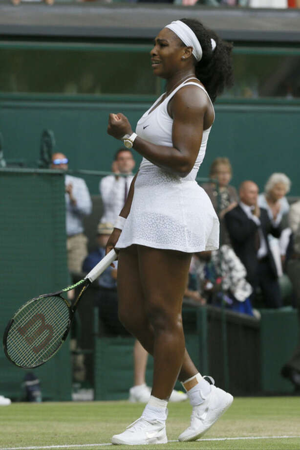 Serena Williams of the United States celebrates as she wins the singles match against Heather Watson of Britain, at the All England Lawn Tennis Championships in Wimbledon, London, Friday July 3, 2015. Williams won 6-2, 4-6, 7-5. (AP Photo/Kirsty Wigglesworth)
