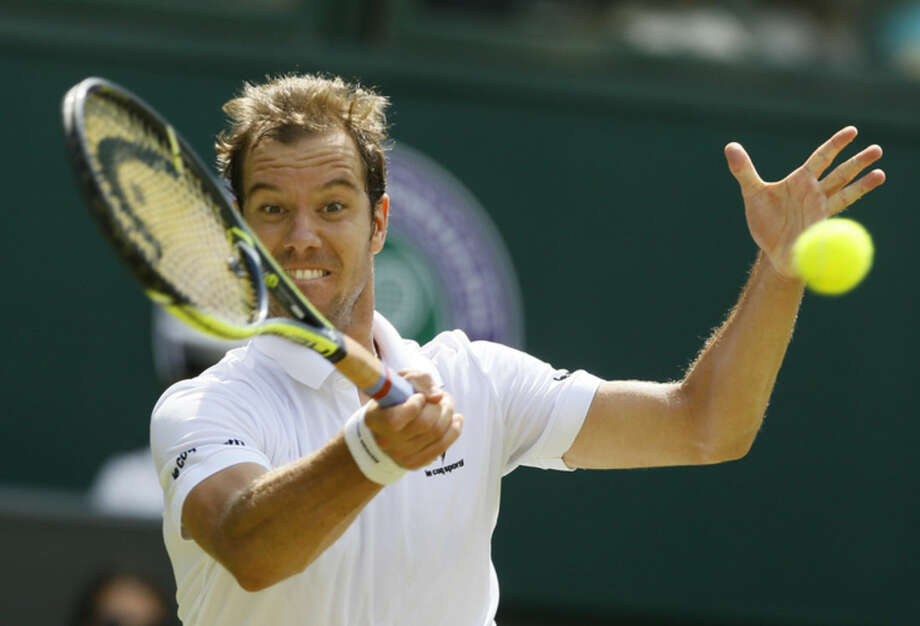 Richard Gasquet of France makes a return to Grigor Dimitrov of Bulgaria during their singles match at the All England Lawn Tennis Championships in Wimbledon, London, Friday July 3, 2015. (AP Photo/Kirsty Wigglesworth)