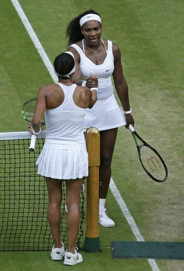 Serena Williams of the United States, top, greets Heather Watson of Britain at the net after winning their singles match at the All England Lawn Tennis Championships in Wimbledon, London, Friday July 3, 2015. (AP Photo/Tim Ireland)