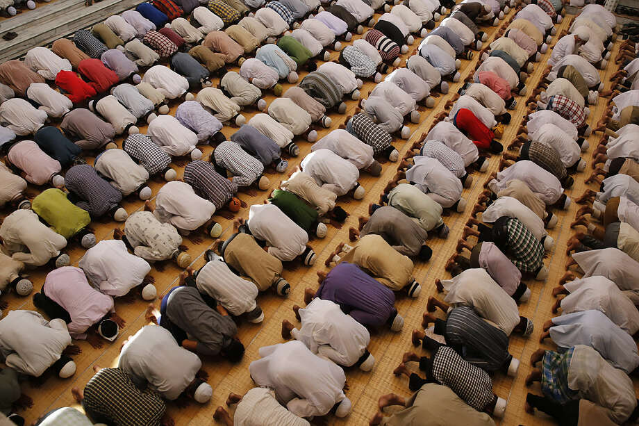 Indian Muslims offer prayers during Ramadan at the Vasi Ullah mosque in Allahabad, India, Friday, July 3, 2015. Muslims throughout the world are marking the holy month of Ramadan, where they fast from dawn till dusk. (AP Photo/Rajesh Kumar Singh)