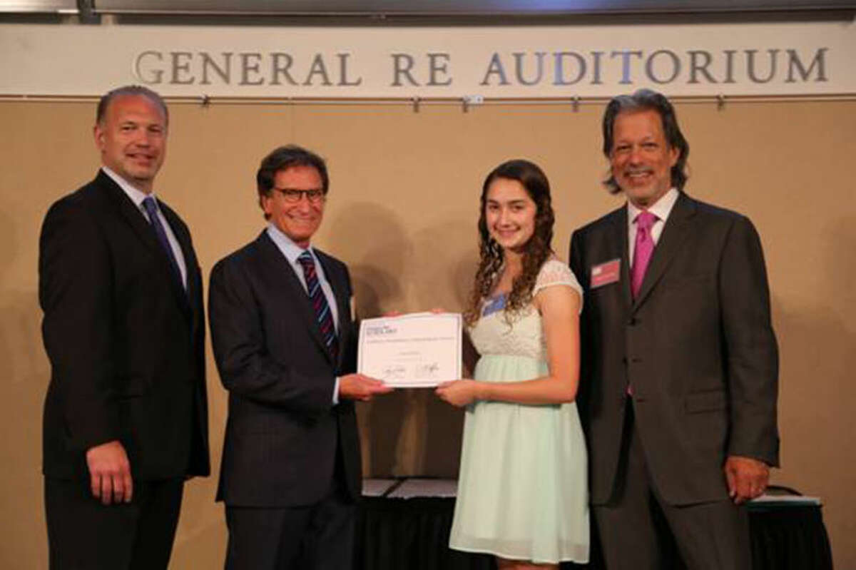 Pictured From left to right: Jim McClafferty, Co-President of Stamford Dollars forScholars, Dr. Robert Goldman presenting the Goldman Orthodontics Scholarship for Science to Julia Schaffer, and Tony D'Amelio, Co-President of Stamford Dollars for Scholars. Julia is one of the 21 Class of 2014 graduates receiving scholarship awards from Stamford Dollars for Scholars. She is a 2014 graduate of Westhill High School who will attend Cornell University with a major in Chemistry/Physics.
