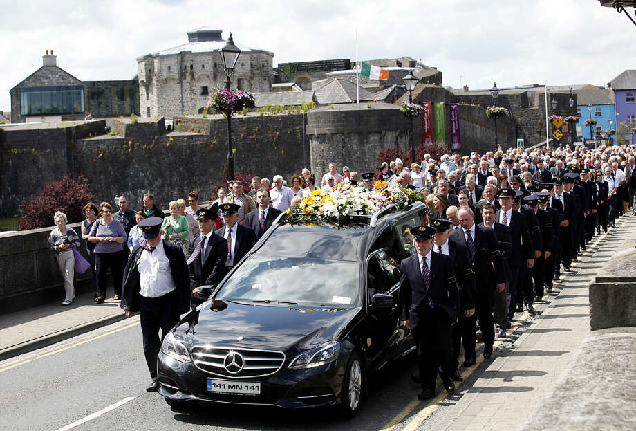 Hearses carry the coffins with cortege for Larry and Martina Hayes from the Church of St Peter & Paul Athlone, Ireland, Friday, July 3, 2015. The couple were killed in a terror attack on a beach in the Tunisian resort of Sousse Friday June 26, where thirty of the 38 dead were British tourists. (AP Photo/Peter Morrison)