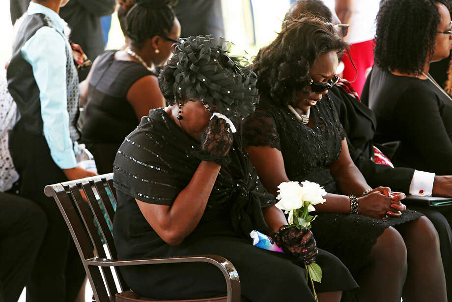 Annie Simmons and daughter Rose Ann Simmons attend a funeral service for Rev. Daniel Simmons Sr. at Fort Jackson National Cemetery in Columbia, S.C., Thursday, July 2, 2015. Simmons was the last of the nine victims of the June 17 shootings at the predominantly black Charleston's Emanuel AME to be buried. (Gerry Melendez/The State via AP) ALL LOCAL MEDIA OUT, (TV, ONLINE, PRINT); MANDATORY CREDIT