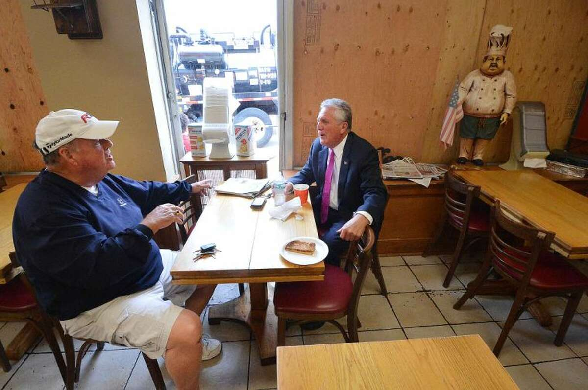 Hour Photo/Alex von Kleydorff Mayor Harry Rilling has lunch and talks with a customer who was inside when the explosion blew the front windows out of Muro's Original New York Bakery on Main St. Monday