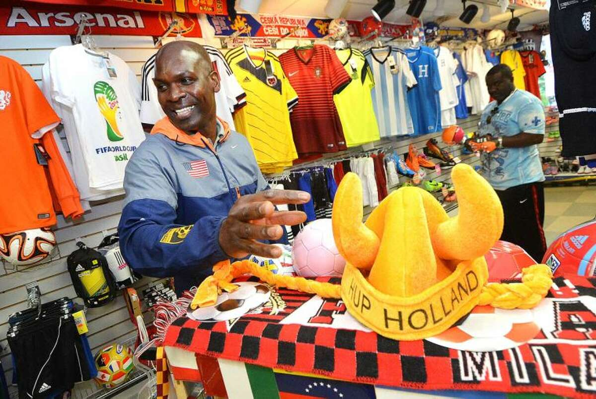 Hour Photo/Alex von Kleydorff Aldwin St. George has most everthing soccer related in his Norwalk Store