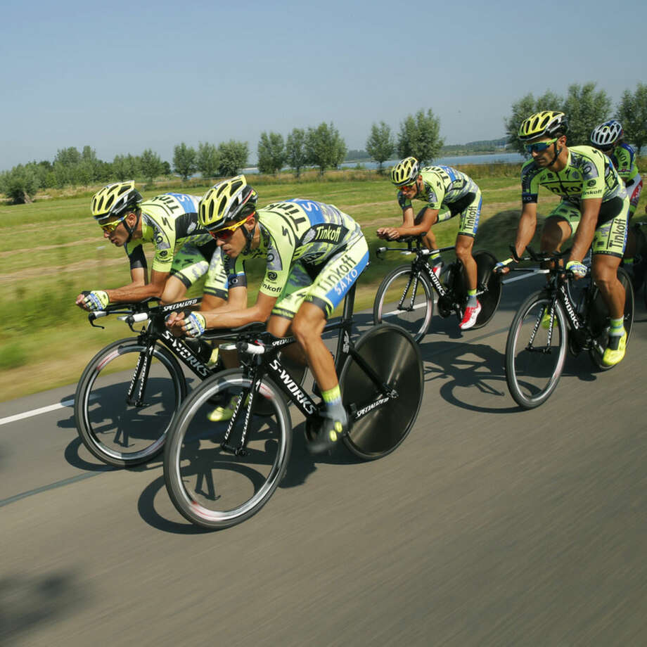 Team Tinkoff-Saxo with Spain's Alberto Contador, second left, trains near Utrecht, Netherlands, Friday, July 3, 2015, one day ahead of the start of the three-week-long Tour de France cycling race over 3,360 kilometers or 2088 miles. (AP Photo/Christophe Ena)