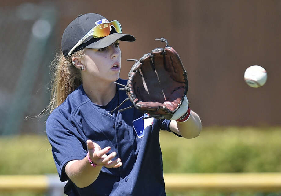 Melissa Mayeux catches a ball at a baseball camp in Paderborn, Germany, Wednesday, July 1, 2015. The 16-year-old player on the French U-18 junior national team, made history when she became the first woman on Major League Baseball's international registration list, making her eligible to be signed by Major League teams. (AP Photo/Martin Meissner)