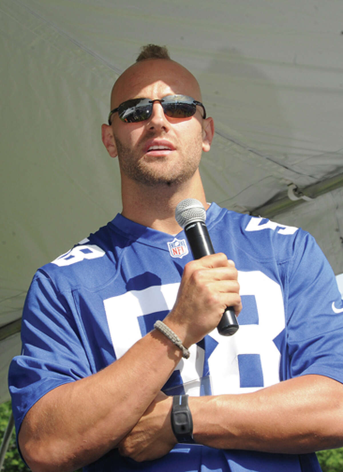 Mark Herzlich, a linebacker for the New York Giants and a Bone Cancer Survivor speaks Sunday at the 5K race for Multiple Myeloma. Hour photo/Matthew Vinci