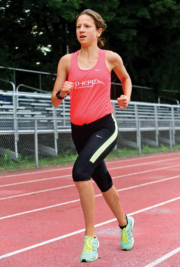 Kristen Curran is the first woman finisher during the Westport Road Runners first race of 10-race series, a 2.3 miler, at Staples High School Saturday.