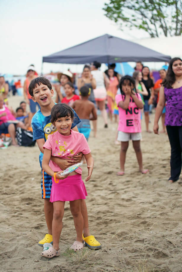 Dalia Katram 5, is hugged by her brother Marko, 8, after winning a Hula competition by DJ Jim Nuzzo before Norwalk's annual firework display at Shady Beach in Norwalk Friday evening. Hour Photo / Danielle Calloway