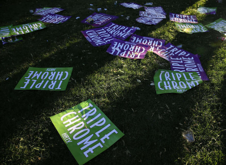Posters supporting California Chrome's bid for the Triple Crown litter the ground at Belmont Park after the horse finished fourth in the Belmont Stakes horse race, Saturday, June 7, 2014, in Elmont, N.Y. (AP Photo/Seth Wenig)