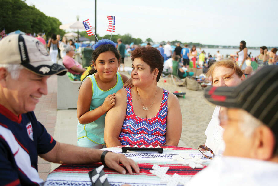 Julissa Acosta and her grandmother Edith Henao sport red white and blue before Norwalk's annual firework display at Calf Pasture Beach in Norwalk Friday evening. Hour Photo / Danielle Calloway