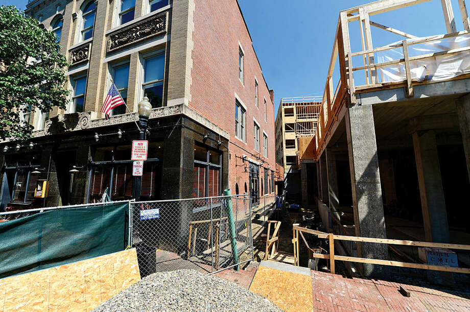 Hour photo / Erik Trautmann The Gingerman restaurant on Washington St is planning to close for renovations later this month and will re-open in September. The renovations include a brand new patio that will be paid for by F.D. Rich who is the developer of the SoNo Pearl which is being built next door.
