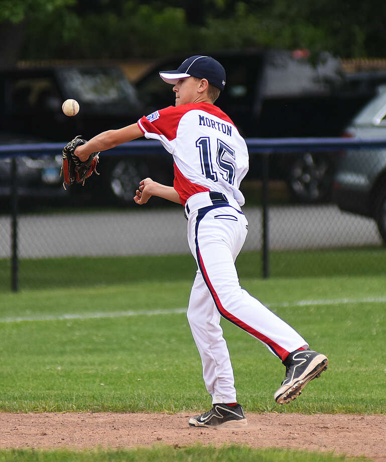 Hour photo/John Nash - Action from Saturday's Norwalk-Ridgefield District 1 12-year-old Little League All-Star game at Frank Noto Field in Stamford.