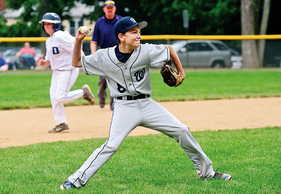 Hour photo / Erik Trautmann Wilton's third baseman Shane McCaghey looks to first during their District 1 Little Leaguegame against Darien National at McGuane Field in Noroton Heights Saturday.