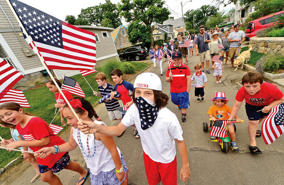 Hour photo / Erik Trautmann Jackson Fiscina, 12, particpates in the Harbor View neighborhood's 92nd July 4th program's annual children's parade to the Association Clubhouse Saturday.
