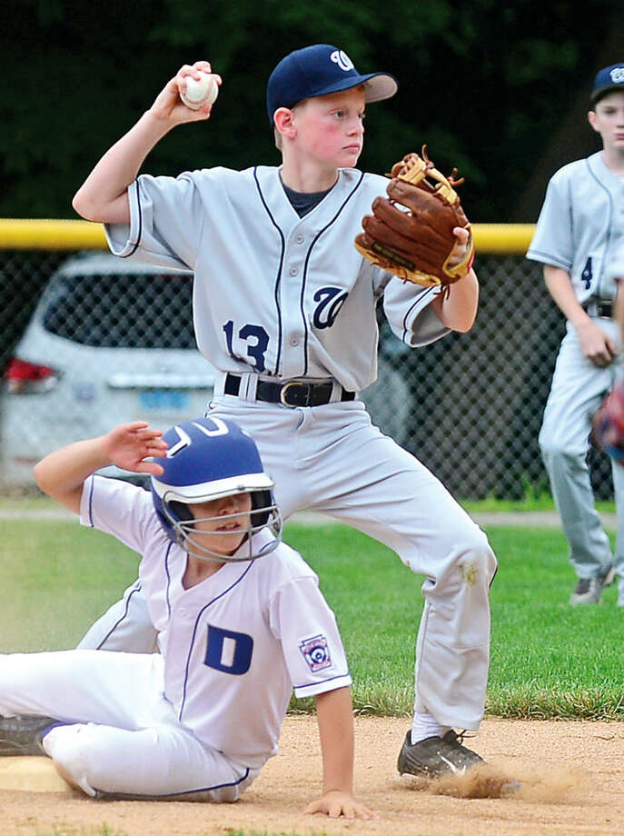 Hour photo / Erik Trautmann Wilton's short stop Chris Cropper looks to turn two after getting out Edmund Steeves during their District 1 Little League game against Darien National at McGuane Field in Noroton Heights Saturday.