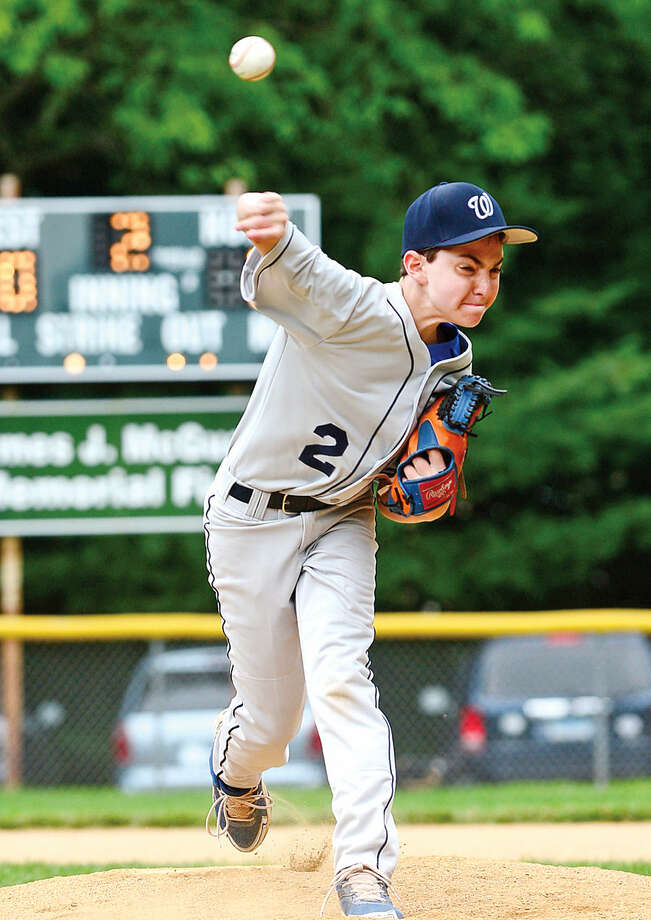 Hour photo / Erik Trautmann Wilton's Jordan Sayewitz pitches during their District 1 Little League game against Darien National at McGuane Field in Noroton Heights Saturday.