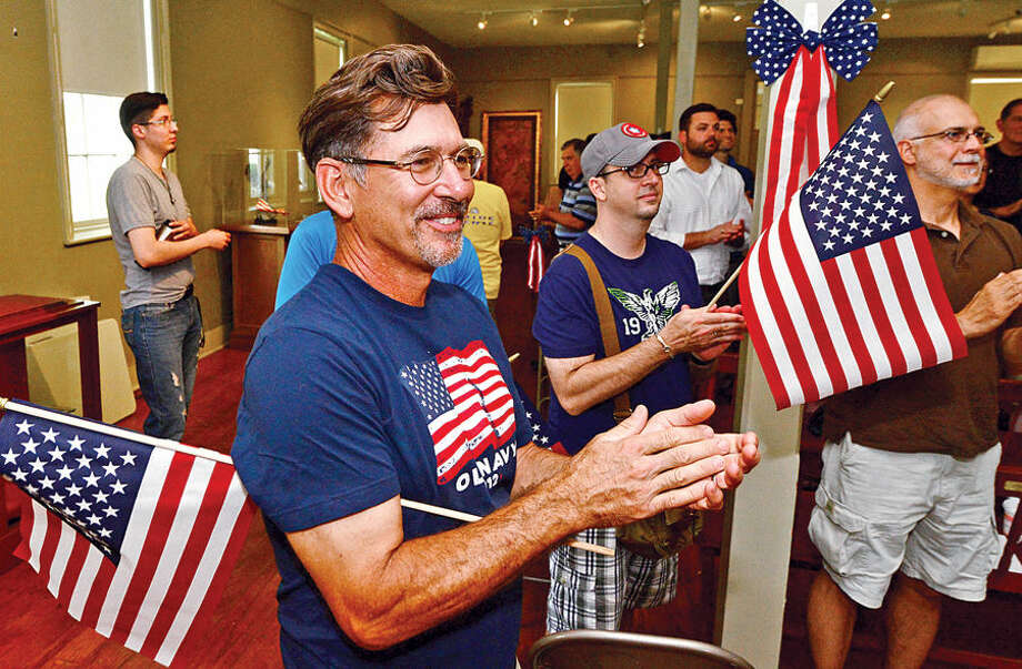 "Hour photo / Erik Trautmann Mike Murshak applaus the program during the Norwalk Historical Society's Independence Day ""Let Freedom Ring"" National Bell Ringing Ceremony Saturday at the Mill Hill Histroic Complex."