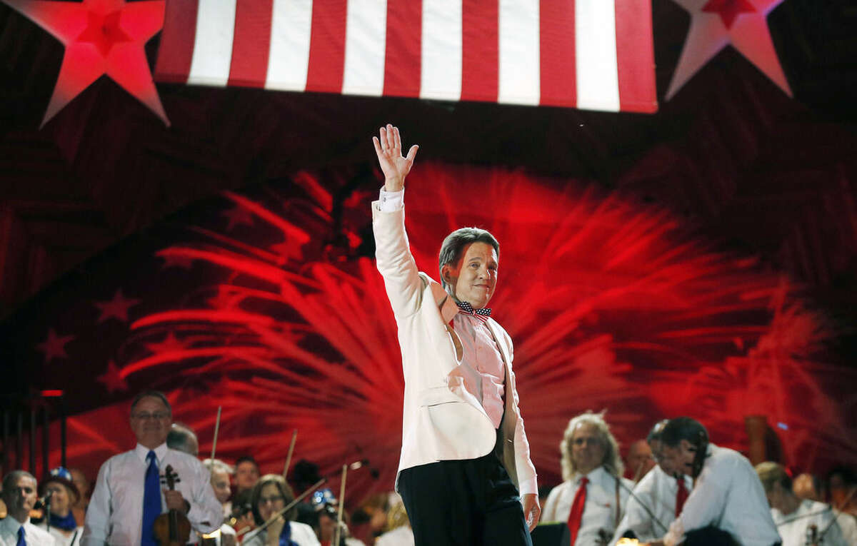 Boston Pops conductor Keith Lockhart gestures at the end of rehearsal for the orchestra's annual Fourth of July concert at the Hatch Shell in Boston, Friday, July 3, 2015. (AP Photo/Michael Dwyer)