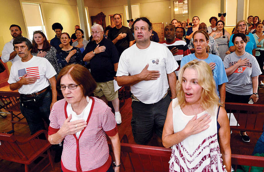 "Hour photo / Erik Trautmann Claudia Parra, lower right, joins other Norwalk residents recite the Pledge of the Allegiance during the Norwalk Historical Society's Independence Day ""Let Freedom Ring"" National Bell Ringing Ceremony Saturday at the Mill Hill Histroic Complex."