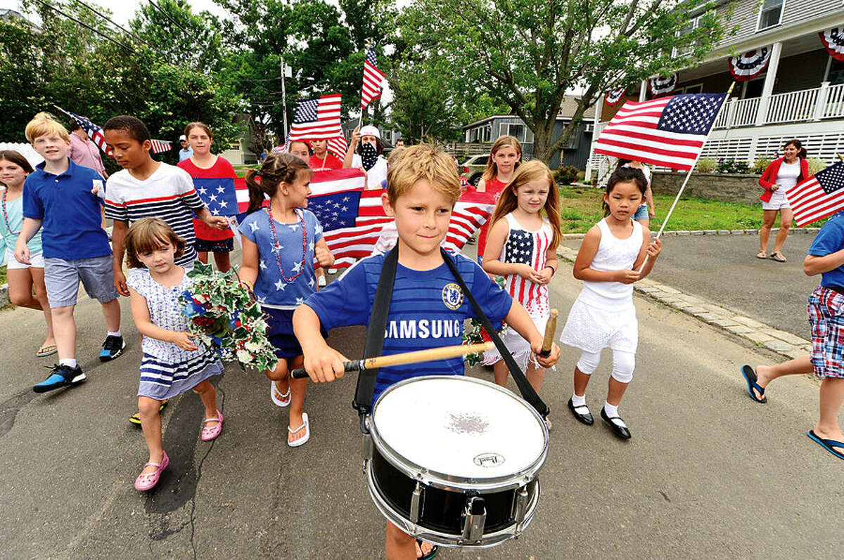 Hour photo / Erik Trautmann Matt Cesare, 7, leads the Harbor View neighborhood's 92nd July 4th program's annual children's parade to the Association Clubhouse Saturday.