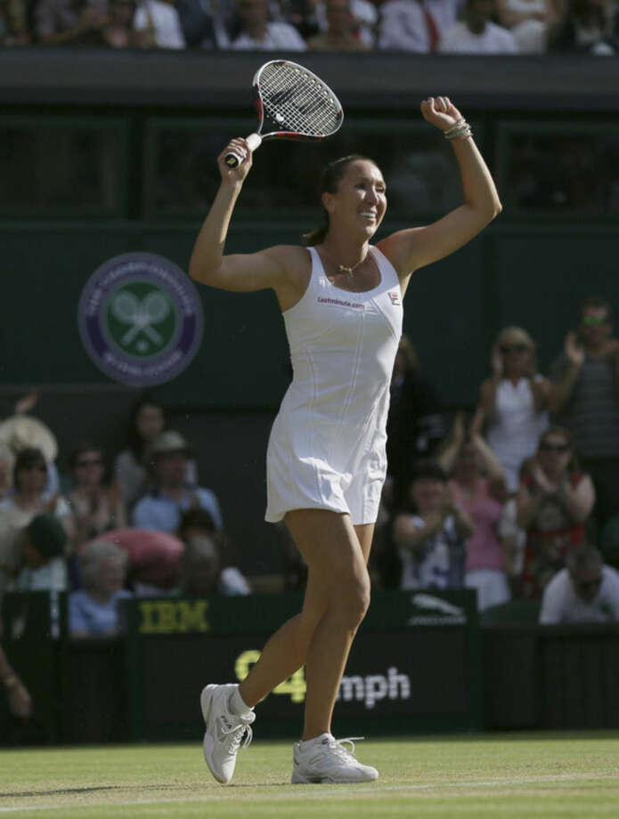 Jelena Jankovic of Serbia celebrates defeating Petra Kvitova of the Czech Republic in their singles match at the All England Lawn Tennis Championships in Wimbledon, London, Saturday July 4, 2015. Jankovic won the match 3-6, 7-5, 6-4. (AP Photo/Tim Ireland)