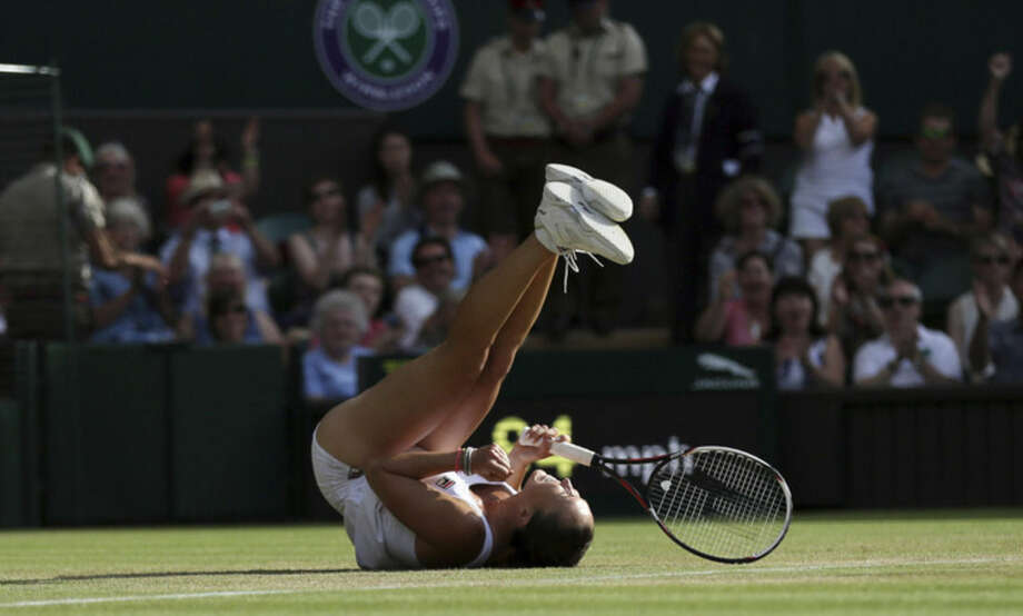 Jelena Jankovic of Serbia celebrates defeating Petra Kvitova of the Czech Republic during their singles match against at the All England Lawn Tennis Championships in Wimbledon, London, Saturday July 4, 2015. Jankovic won the match 3-6, 7-5, 6-4. (AP Photo/Tim Ireland)