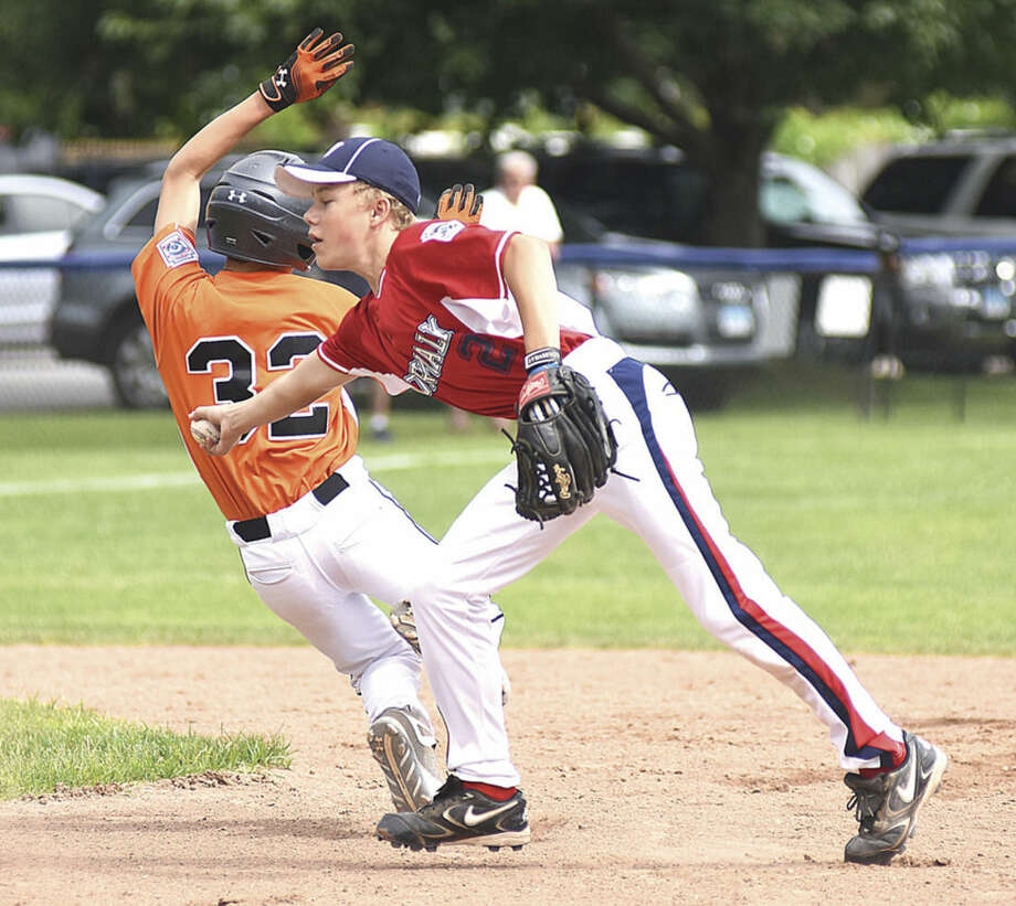 Hour photo/John NashNorwalk 12-year-old All-Star second baseman Landon Heatly just misses a tag on Ridgefield baserunner Luke Barrientos during Saturday's District 1 Little League tournament gmae at Frank Noto Field in Stamford. Ridgefield remained unbeaten with a 9-3 win.