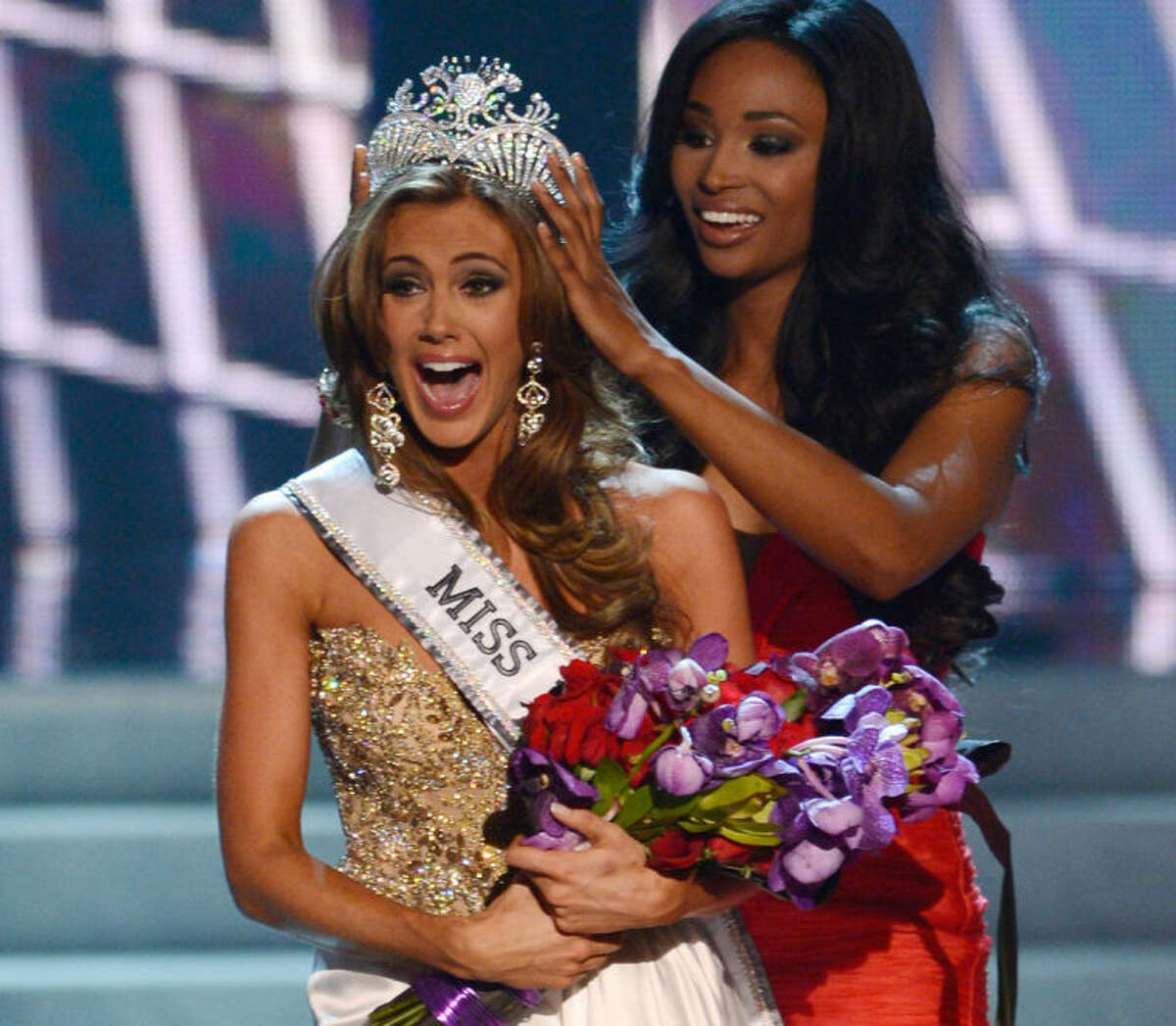 FILE - In this Sunday, June 16, 2013, file photo, Miss Connecticut Erin Brady is crowned the winner of the Miss USA 2013 pageant by Nana Meriwether in Las Vegas. Brady, of South Glastonbury, Conn., relinquishes her crown Sunday, June 8, 2014, when the 2014 pageant competition being held in Baton Rouge, La., selects a new Miss USA. (AP Photo/Jeff Bottari, File)