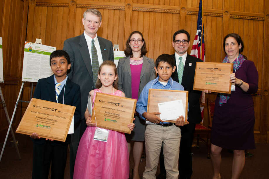 Third-grader Yash Bhandari (far right) won 3rd Place in the 10th annual eesmarts Student Contest. Yash is pictured with Ken Bowes, vice president of engineering for CL&P, Marissa Westbrook, manager of residential energy services for The United Illuminating Company and Rob Klee, commissioner of the Connecticut Department of Energy and Environmental Protection.