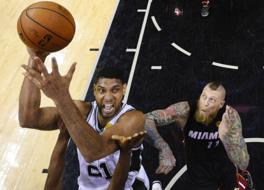 San Antonio Spurs forward Tim Duncan (21) shoots as Miami Heat forward Chris Andersen (11) defends during the second half in Game 2 of the NBA basketball finals on Saturday, Nov. 8, 2014, in San Antonio. (AP Photo/Larry W. Smith, pool)