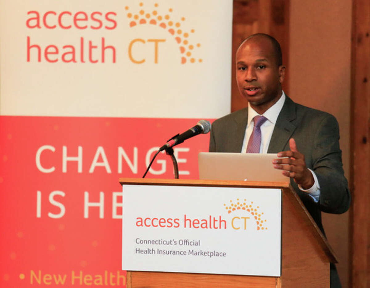 Chris Palermo / Hour Photo. Access Health Outreach Coordinator Loo Goodall address the crowd during the overview of the healthcare reform put on by Access Health CT at City Hall Thursday night.
