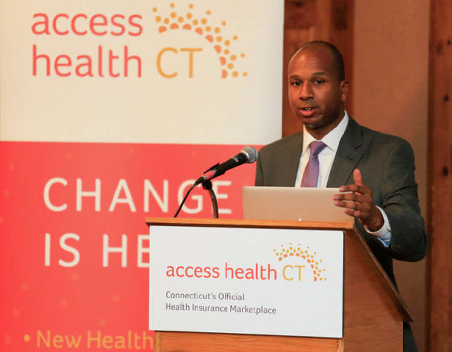 Chris Palermo / Hour Photo. Access Health Outreach Coordinator Loo Goodall address the crowd during the overview of the healthcare reform put on by Access Health CT at City Hall Thursday night. / © 2013 Hour Newspapers All Rights Reserved