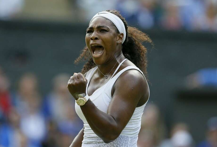 Serena Williams of the United States celebrates after winning a point against Heather Watson of Britain during their singles match at the All England Lawn Tennis Championships in Wimbledon, London, Friday July 3, 2015. (AP Photo/Kirsty Wigglesworth)