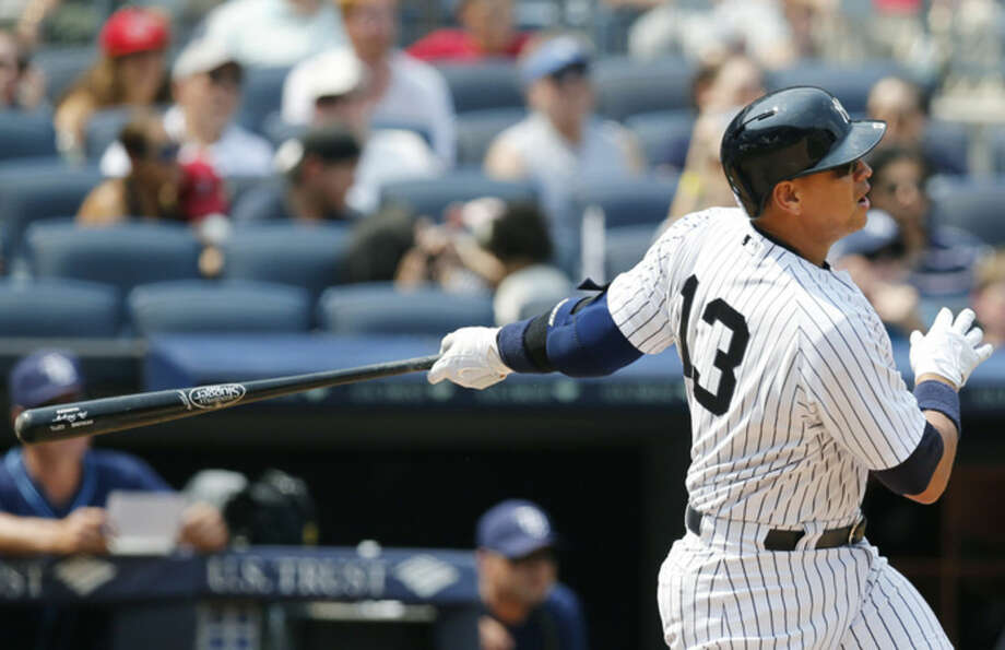 New York Yankees designated hitter Alex Rodriguez hits a sixth-inning, solo, home run in a baseball game at Yankee Stadium in New York, Sunday, July 5, 2015. (AP Photo/Kathy Willens)